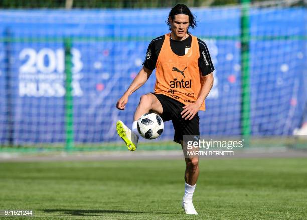 Uruguay's forward Edinson Cavani controls the ball as he takes part in a training session of Uruguay national football team ahead of the Russia 2018...