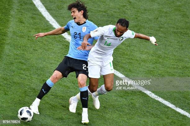 Uruguay's forward Edinson Cavani fights for the ball with Saudi Arabia's midfielder Abdullah Otayf during the Russia 2018 World Cup Group A football...