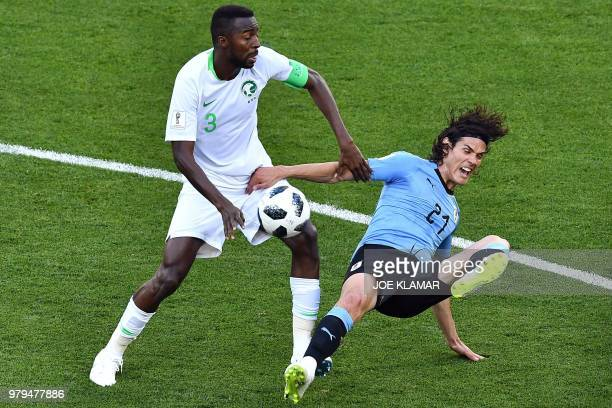 Uruguay's forward Edinson Cavani fights for the ball with Saudi Arabia's defender Osama Hawsawi during the Russia 2018 World Cup Group A football...