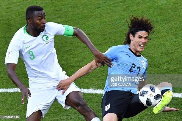 TOPSHOT Uruguay's forward Edinson Cavani fights for the ball with Saudi Arabia's defender Osama Hawsawi during the Russia 2018 World Cup Group A...