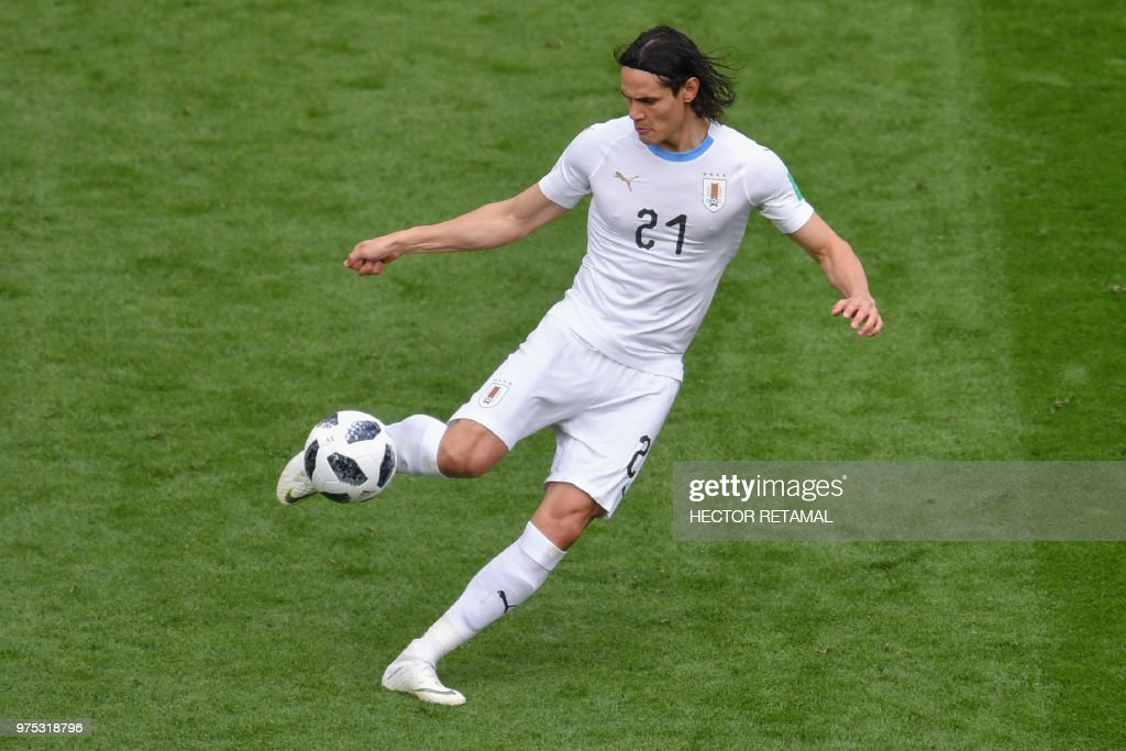 TOPSHOT - Uruguay's forward Edinson Cavani kicks the ball during the Russia 2018 World Cup Group A football match between Egypt and Uruguay at the Ekaterinburg Arena in Ekaterinburg on June 15, 2018. (Photo by HECTOR RETAMAL / AFP) / RESTRICTED