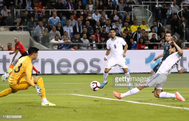 Uruguay's forward Edinson Cavani kicks the ball to the goal during the friendly football match between Argentina and Uruguay at the Bloomfield...