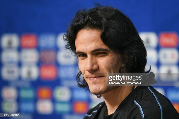 TOPSHOT Uruguay's forward Edinson Cavani looks on during a press conference on the eve of the Russia 2018 World Cup Group A football match between...