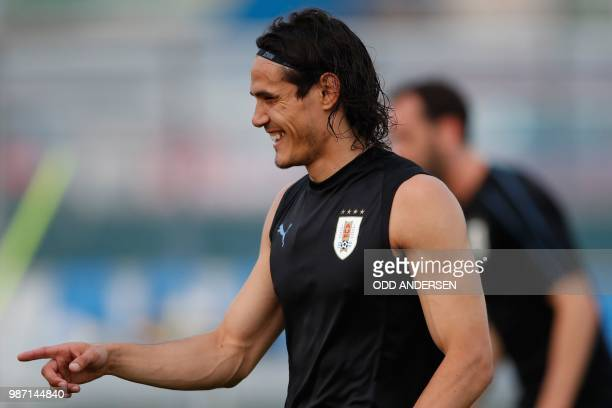 Uruguay's forward Edinson Cavani reacts as he takes part in a training session of Uruguay's national football team at the Park Arena in Sochi on June...