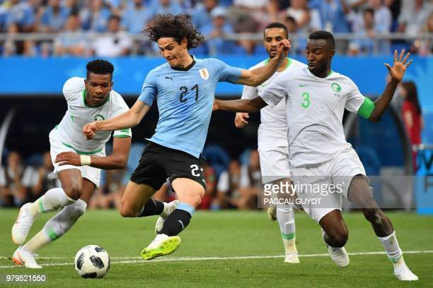 Uruguay's forward Edinson Cavani vies with Saudi Arabia's defender Osama Hawsawi during the Russia 2018 World Cup Group A football match between...