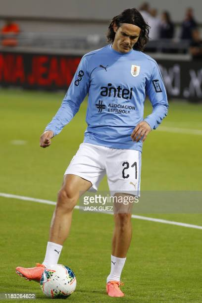 Uruguay's forward Edinson Cavani warms up before the friendly football match between Argentina and Uruguay at the Bloomfield stadium in the Israeli...