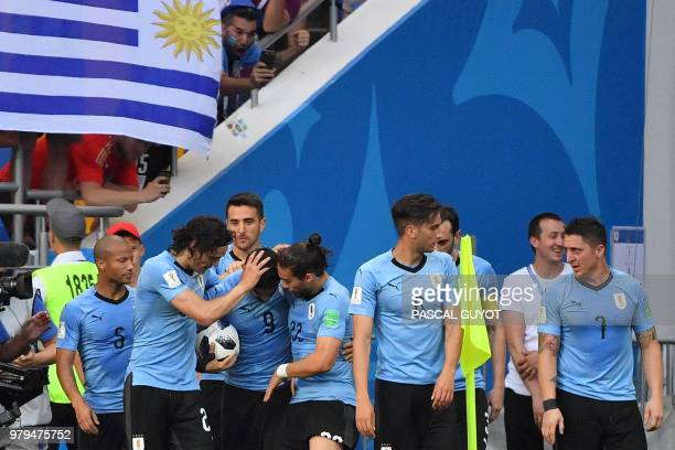 TOPSHOT Uruguay's forward Luis Suarez celebrates a goal with teammates during the Russia 2018 World Cup Group A football match between Uruguay and...