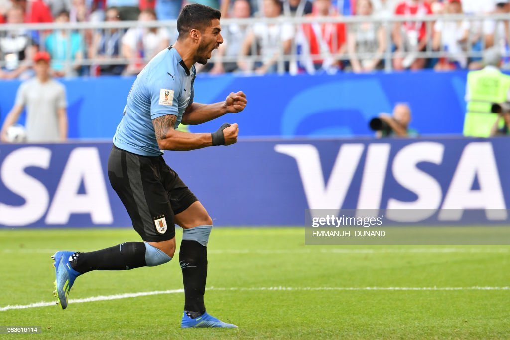 TOPSHOT - Uruguay's forward Luis Suarez celebrates his team's second goal during the Russia 2018 World Cup Group A football match between Uruguay and Russia at the Samara Arena in Samara on June 25, 2018. (Photo by EMMANUEL DUNAND / AFP) / RESTRICTED