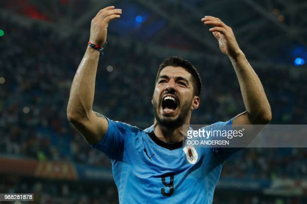 Uruguay's forward Luis Suarez celebrates his teams win during the Russia 2018 World Cup round of 16 football match between Uruguay and Portugal at...