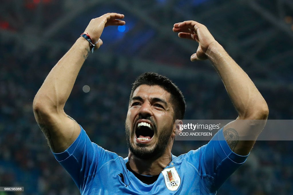 TOPSHOT - Uruguay's forward Luis Suarez celebrates his teams win during the Russia 2018 World Cup round of 16 football match between Uruguay and Portugal at the Fisht Stadium in Sochi on June 30, 2018. - Uruguay sent Cristiano Ronaldo and Portugal crashing out of the World Cup on Saturday as a pair of stunning goals from Edinson Cavani gave the South Americans a 2-1 victory. (Photo by Odd ANDERSEN / AFP) / RESTRICTED
