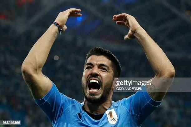 TOPSHOT Uruguay's forward Luis Suarez celebrates his teams win during the Russia 2018 World Cup round of 16 football match between Uruguay and...