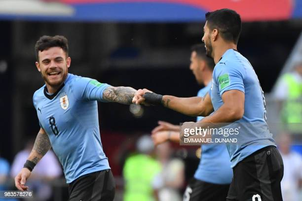 Uruguay's forward Luis Suarez celebrates with Uruguay's midfielder Nahitan Nandez after scoring a goal during the Russia 2018 World Cup Group A...