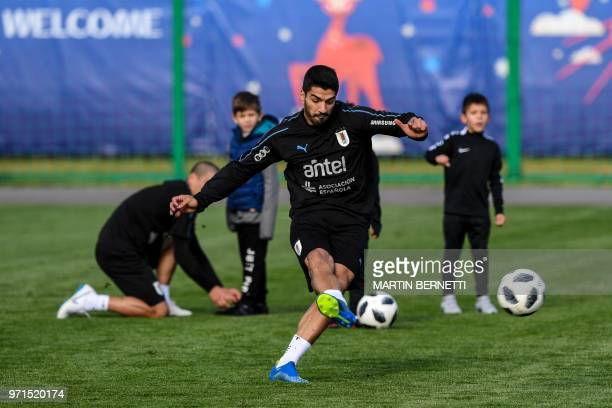 Uruguay's forward Luis Suarez controls the ball as he takes part in a training session of Uruguay national football team ahead of the Russia 2018...