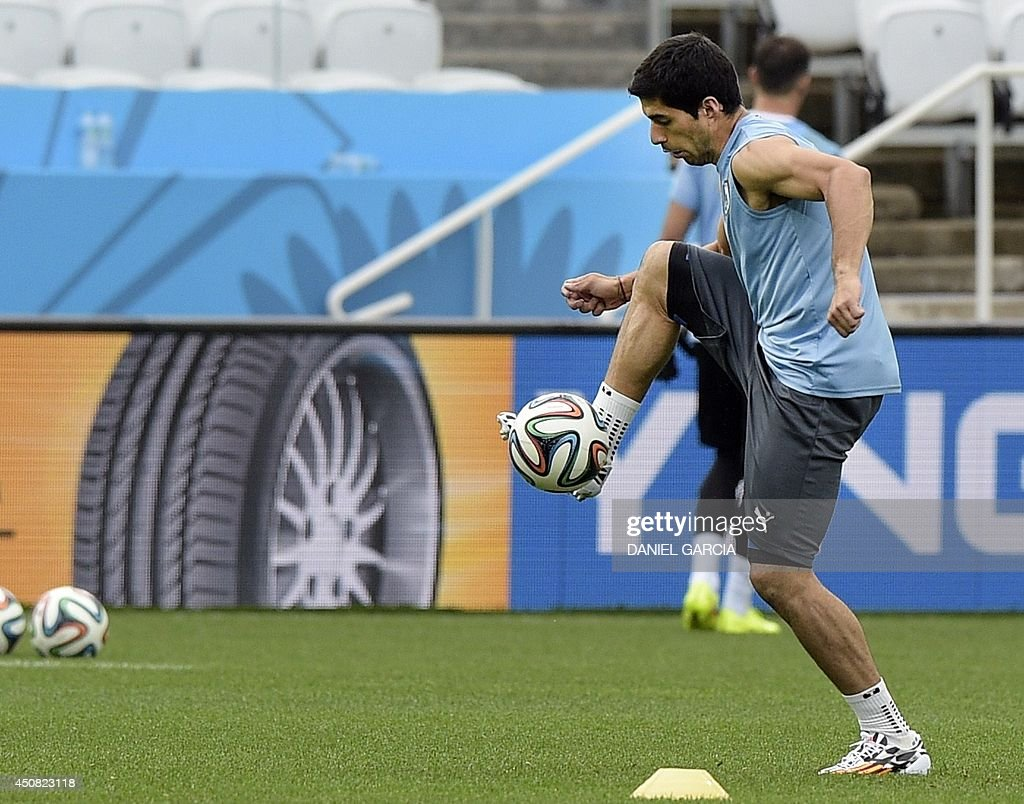 Uruguay's forward Luis Suarez controls the ball during a training session at Corinthians Arena in Sao Paulo on June 18, 2014, on the eve of a FIFA World Cup Group D football match between Uruguay and England.