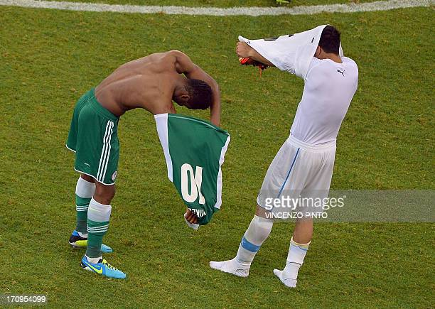 Uruguay's forward Luis Suarez exchanges jerseys with Nigeria's midfielder John Obi Mikel at the end of the FIFA Confederations Cup Brazil 2013 Group...