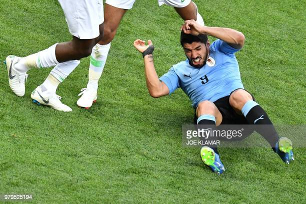 TOPSHOT Uruguay's forward Luis Suarez falls during the Russia 2018 World Cup Group A football match between Uruguay and Saudi Arabia at the Rostov...