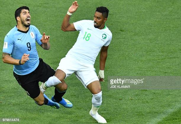 Uruguay's forward Luis Suarez fights for the ball with Saudi Arabia's forward Salem AlDawsari during the Russia 2018 World Cup Group A football match...