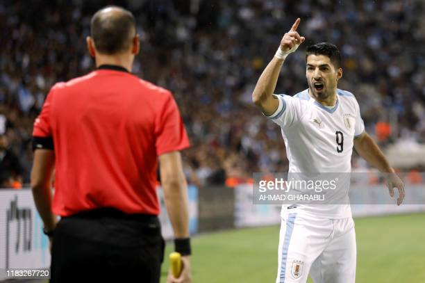 Uruguay's forward Luis Suarez gestures at the referee during the friendly football match between Argentina and Uruguay at the Bloomfield stadium in...