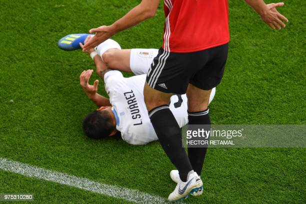 Uruguay's forward Luis Suarez goes down after being fouled by Egypt's defender Ahmed Hegazi during the Russia 2018 World Cup Group A football match...