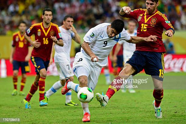 Uruguay's forward Luis Suarez is marked by Spain's defender Sergio Ramos during the FIFA Confederations Cup Brazil 2013 Group B football match, at...