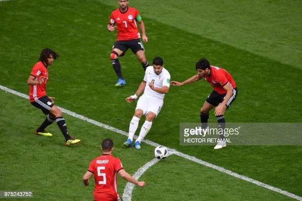 Uruguay's forward Luis Suarez is surrounded by Egypt's midfielder Mohamed Elneny Egypt's defender Ahmed Fathi Egypt's midfielder Sam Morsy and...