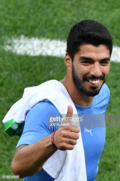 Uruguay's forward Luis Suarez pushes a thumb up at the end of the Russia 2018 World Cup Group A football match between Uruguay and Saudi Arabia at...