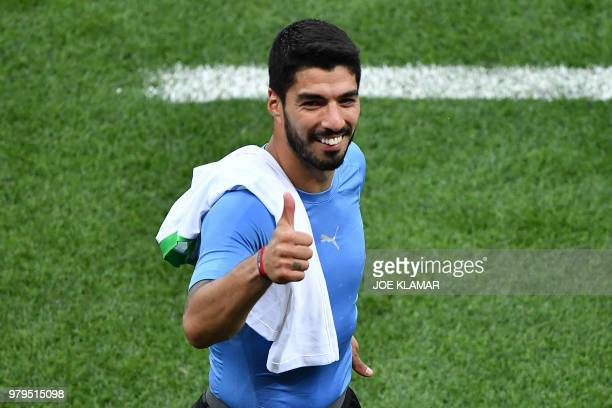TOPSHOT Uruguay's forward Luis Suarez pushes a thumb up at the end of the Russia 2018 World Cup Group A football match between Uruguay and Saudi...