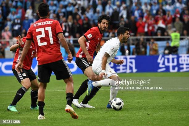 Uruguay's forward Luis Suarez reacts after being fouled by Egypt's defender Ahmed Hegazi during the Russia 2018 World Cup Group A football match...