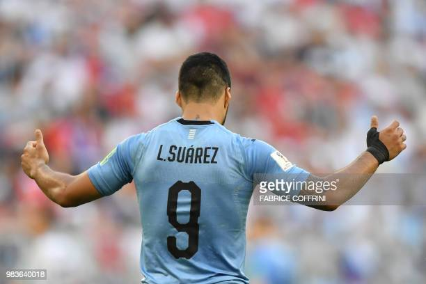 TOPSHOT Uruguay's forward Luis Suarez reacts during the Russia 2018 World Cup Group A football match between Uruguay and Russia at the Samara Arena...