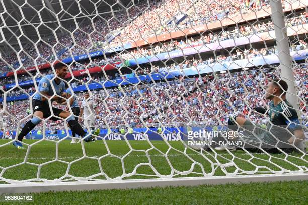 Uruguay's forward Luis Suarez reacts opposite Russia's goalkeeper Igor Akinfeev after Uruguay's second goal during the Russia 2018 World Cup Group A...