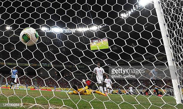 Uruguay's forward Luis Suarez scores past Tahiti's goalkeeper Gilbert Meriel during their FIFA Confederations Cup Brazil 2013 Group B football match...