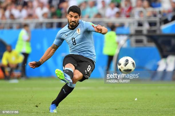 TOPSHOT Uruguay's forward Luis Suarez shoots during the Russia 2018 World Cup Group A football match between Uruguay and Saudi Arabia at the Rostov...