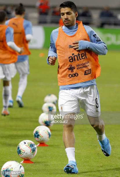 Uruguay's forward Luis Suarez warms up before the friendly football match between Argentina and Uruguay at the Bloomfield stadium in the Israeli...