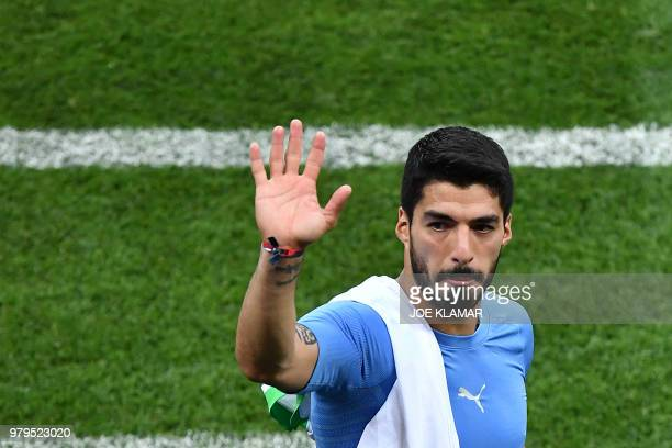 Uruguay's forward Luis Suarez waves to fans at the end of the Russia 2018 World Cup Group A football match between Uruguay and Saudi Arabia at the...