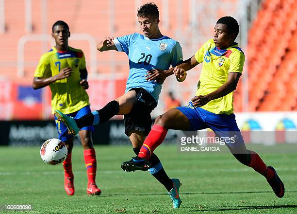 Uruguay's forward Nicolas Lopez vies for the ball with Ecuador's midfielder Michael Arboleda during their South American U20 final round football...