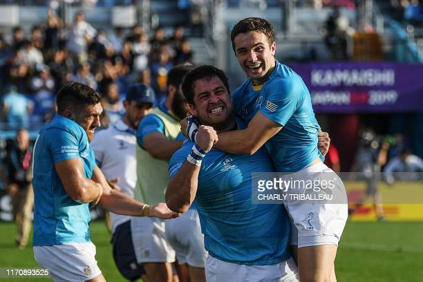 Uruguay's full back Felipe Etcheverry and Uruguay's prop Facundo Gattas celebrate after winning the Japan 2019 Rugby World Cup Pool D match between...