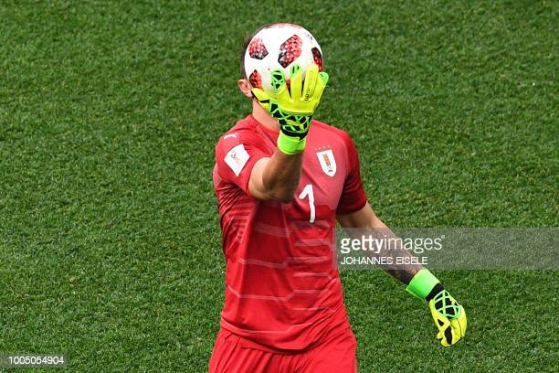 Uruguay's goalkeeper Fernando Muslera holds onto the ball during the Russia 2018 World Cup quarterfinal football match between Uruguay and France at...