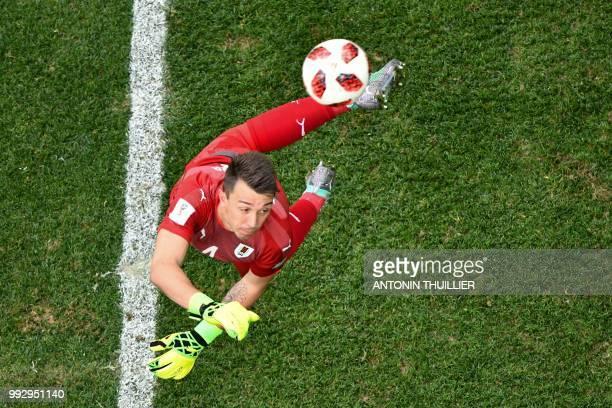 TOPSHOT Uruguay's goalkeeper Fernando Muslera turns the ball into his own net during the Russia 2018 World Cup quarterfinal football match between...