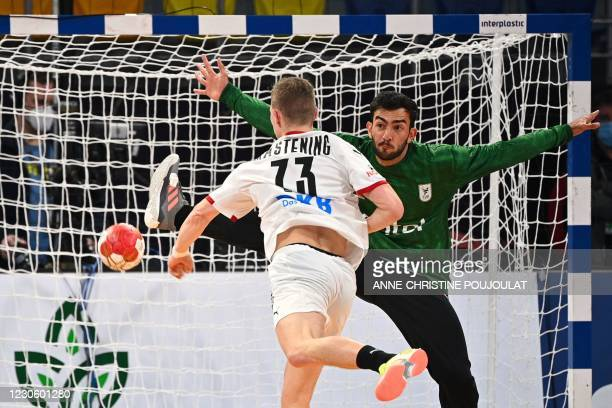 Uruguay's goalkeeper Luis Felipe Navarrete Gambino tries to stop a shot by Germany's right winger Timo Kastening during the 2021 World Men's Handball...