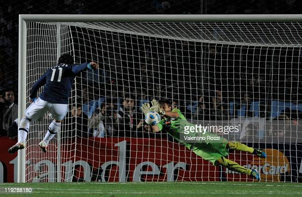 Uruguay's goalkeeper Nestor Muslera cach the Argentina's Carlos Tevez penalty during 2011 Copa America soccer match as part of quarter final at...