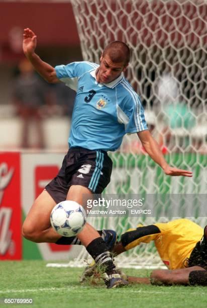 Uruguay's Gonzalo Sorondo tussles with Mali goalkeeper Boubacar Keita