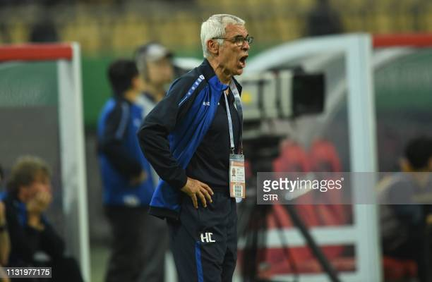 Uruguay's head coach Hector Raul Cuper reacts during the 2019 China Cup football match between Uruguay and Uzbekistan in Nanning in China's southern...