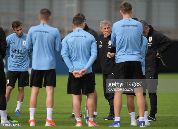 Uruguay's head coach Oscar Tabarez talks to the team during a training session in Porto Alegre Brazil on June 19 on the eve of their Copa America...