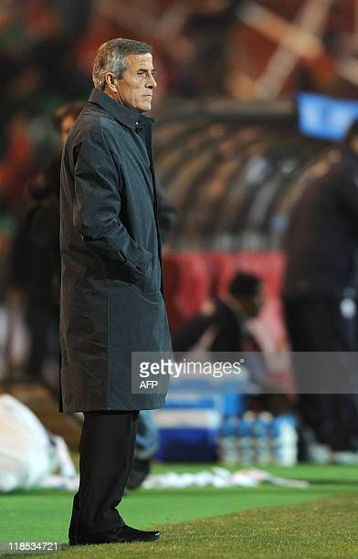 Uruguay's head coach Oscar Tabarez watches the pitch during a 2011 Copa America Group C first round football match against Chile held at the Malvinas...