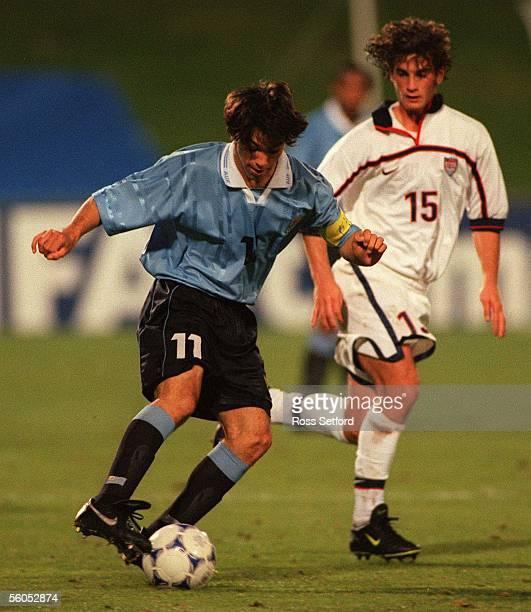 Uruguay's Horacio Peralta slips past USA's Kyle Beckerman in the FIFA under 17 World Championship at North Harbour Stadium Albany TuesdayUSA won 10