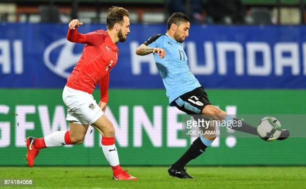 Uruguay's Jonathan Urretaviscaya and Austria's Aleksandar Dragovic vie for the ball during the international friendly football match Austria v...