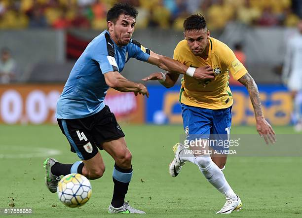 Uruguay's Jorge Fucile and Brazil's Neymar vie during their Russia 2018 FIFA World Cup South American Qualifiers' football match in Recife...