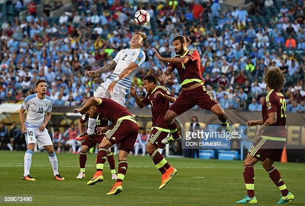 Uruguay's Jose Maria Gimenez and Venezuela's Oswaldo Vizcarrondo jump for a header during the Copa America Centenario football match in Philadelphia...