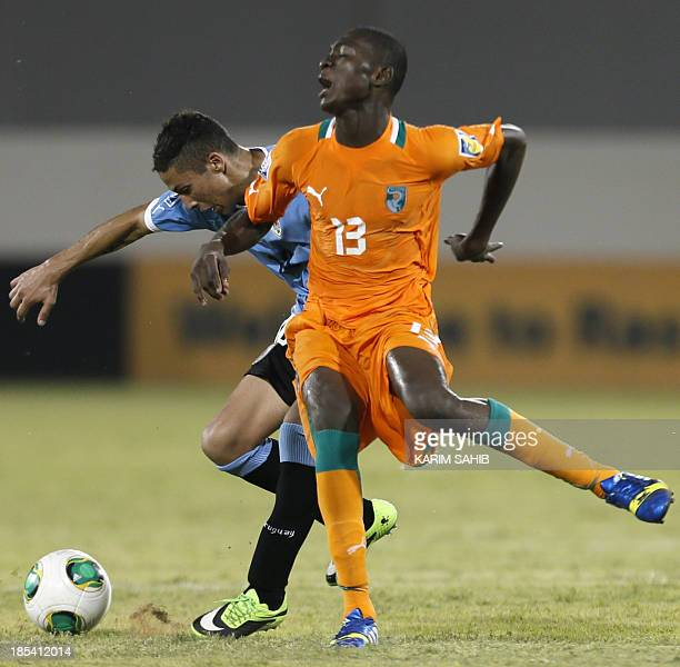 Uruguay's Kevin Mendez vies for the ball against Cote d'Ivoire's Aboubakar Keita during their FIFA U17 World Cup UAE 2013 football match at the...