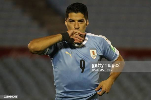 Uruguay's Luis Suarez celebrates after scoring a penalty against Chile during their 2022 FIFA World Cup South American qualifier football match at...